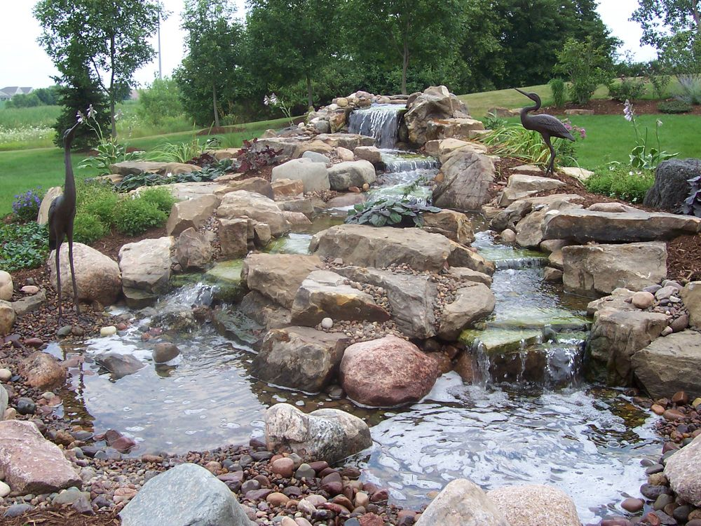The best front yard landscaping with stones for your house for Pictures of backyard waterfalls